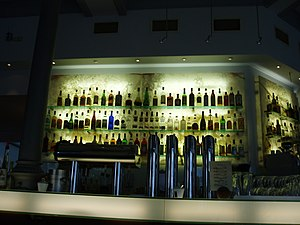 A bar with all the bottles backlit.