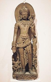 Avalokiteśvara holding a lotus flower.Nālandā, Bihar, India, 9th century CE.