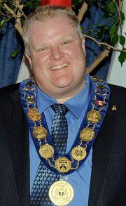 Rob Ford, mayor of Toronto, greeting a nun at ...