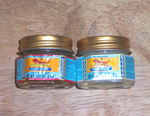 The white and red versions of Haw Par Tiger Balm.