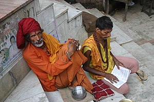 Sadhu with apprentice in Assam, India.