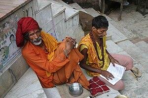 Sadhu with apprentice in Assam, India.