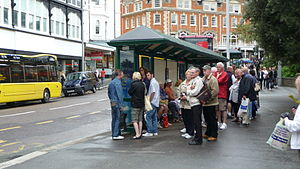 "English: A large queue, or rather ""group&..."