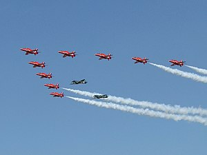 Red Arrows in formation with two Supermarine S...