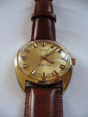 Pontiac Maillot Jaune wristwatch. gold wristwa...