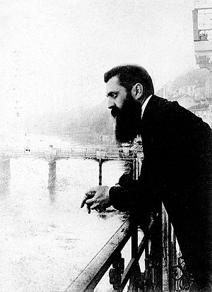 Theodor Herzl leaning over the balcony of the ...