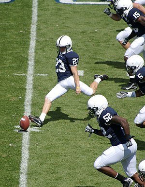 English: Kevin Kelly kicks off for the Nittany...