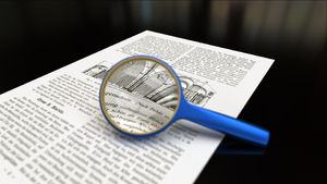 English: Magnifying glass with focus on paper....
