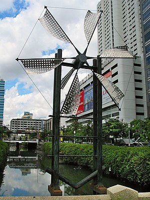 Windmill sculpture, Silom Road, Bangkok, Thailand.