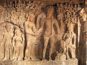 English: Wall sculptures at Ellora Caves. A sc...