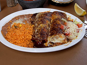 Enchilada, rice, and beans.