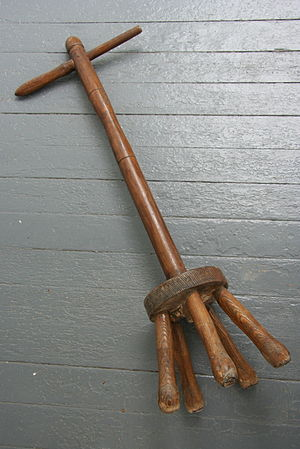 An old wooden manual agitator: a tool to assis...