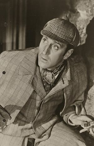 Photograph of Basil Rathbone as Sherlock Holme...
