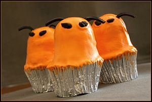 English: Cupcakes in the shape of orange extra...