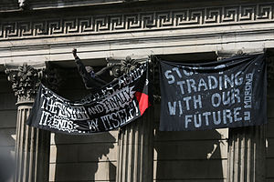 One protester scaled pillars to hang banners o...