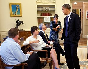 President Barack Obama Oval Office listens to ...