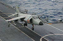 Sea Harrier landing on aircraft carrier INS Vi...