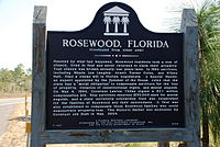 A color photograph of the back of the bronze plaque in Rosewood