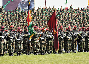 Members of the Afghan national army stand in f...