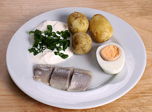 English: Traditional pickled herring with sour...