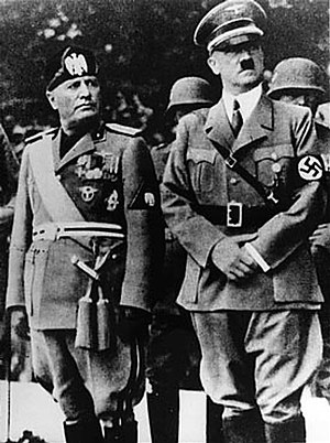 Benito Mussolini and Adolf Hitler stand togeth...