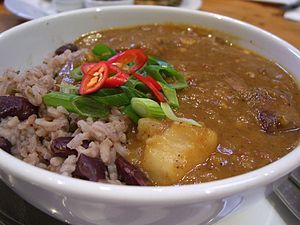 Curry goat with rice a peas (in this case kidn...