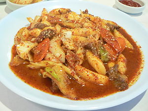 Ddeokbokki (panbroiled rice cakes with vegetab...
