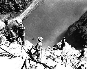 English: High scalers drilling into canyon wal...