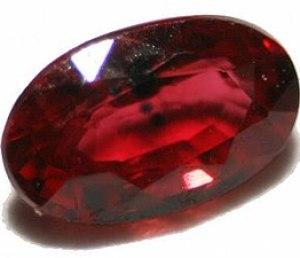 English: cut ruby gemstone with inclusions