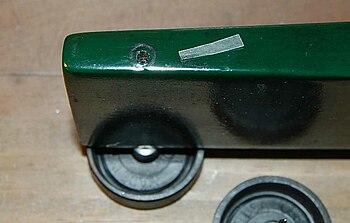 Pinewood derby car wax paper wheel shim.