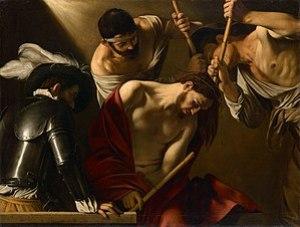 Jesus with a royal purple robe mocked and beat...
