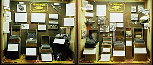 A selection of seven Enigma machines and parap...