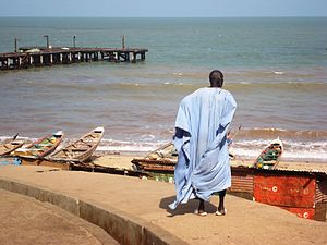English: Old Gambian fisherman looking out to sea
