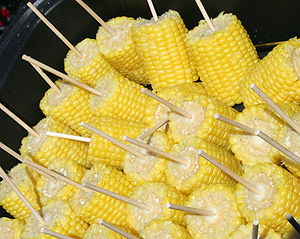 English: Ears of corn on the cob with sticks, ...