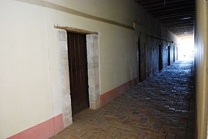 hallway with doors to monks' cells at the form...