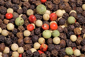 A mixture of black peppercorns from the Malaba...
