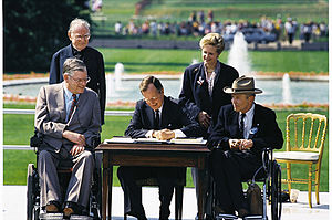 English: President George H. W. Bush signs the...