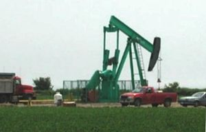 Nodding donkey pumping an oil well near Sarnia...