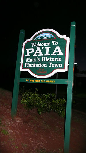Signs welcoming visitor the Paia, Maui. Under ...