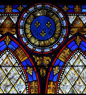 detail of a stained glass windows with the CoA...
