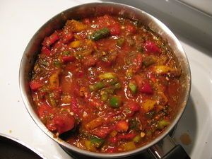 A sauce containing tomato puree, diced tomatoe...