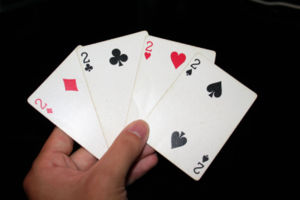 The twos of all four suits in playing cards
