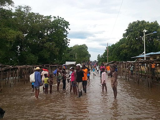 People stand in a flooded street that usually serves as a farmers market, in Ouanaminthe, northeast Haiti, Sept. 8, 2017. (Photo - Josiah Cherenfant, courtesy VOA Creole Service)