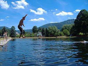 Slackline above water at the outside swimming ...