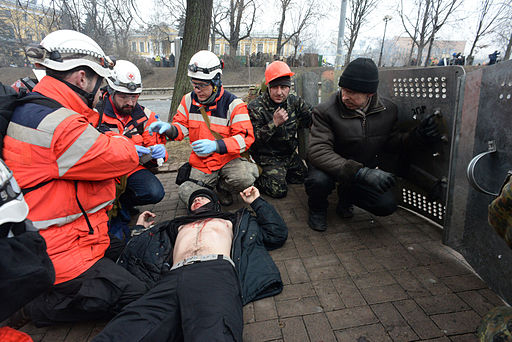 Ukrainian Red Cross volunteers performing first medical aid as the clashes rage in Kyiv, Ukraine. Events of February 20, 2014