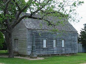 Description: Replica of the building where the...