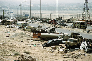 Demolished vehicles line Highway 80, also know...