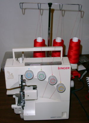 Singer 14U344B overlock sewing machine set for...