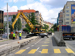 1994–2008, RFE/RL used the former Federal Parliament building of the abolished Czechoslovakia in Prague New Town. For many years past 2001, security concrete barriers reduced capacity of the most frequented roads in Prague center.