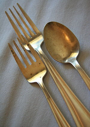 Silverware: salad fork, dinner fork, and spoon